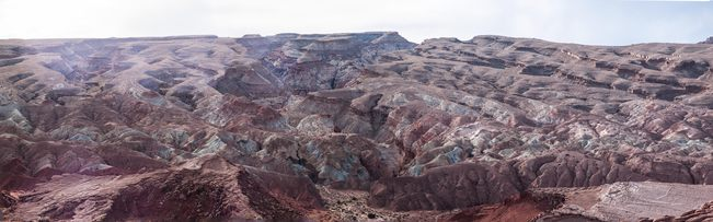wide shot of the San Rafael Swell, cut with a dozen canyons like little ridges in paper